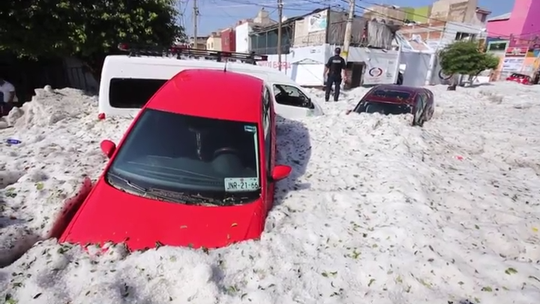 Freak summer hailstorm engulfs Guadalajara's cars, streets in up to 6 feet of ice