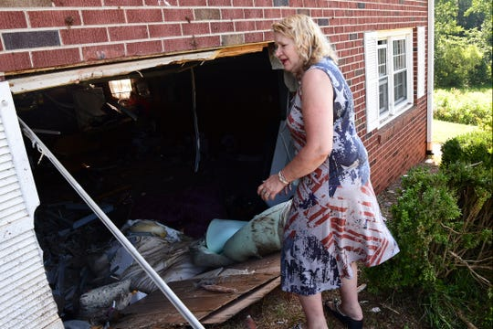 Shirley Neimeyer looks at the basement of her Seneca home, where a car crashed into it on Monday, July 1, 2019, killing her daughter, Vanessa Neimeyer, who was asleep in her bed.