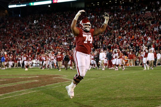 Oklahoma Sooners offensive lineman Cody Ford (74) reacts after the Nov. 10 game against the Oklahoma State.