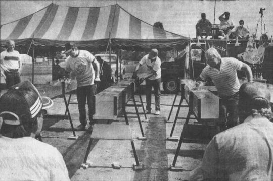 Catfish racers ready their chutes during the first catfish races event in Greenville in 1989.