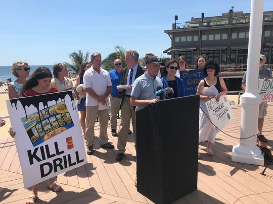 John Weber of the Surfrider Foundation speaks against a proposal to drill offshore for gas and oil while at Pier Village in Long Branch.
