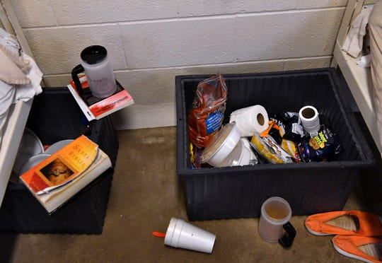 Inmate belonging are kept in plastic boxes beside their bunk in a group cell at the Taylor County Jail.