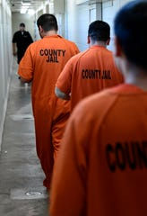Prisoners return to their cells with their lunch June 21, 2019 at the Taylor County Jail.
