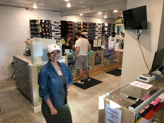 Briana Serrato, general manager of Remedii Natural Health, inside the now open medical marijuana provisioning center in Battle Creek.