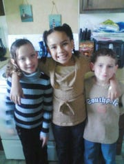 Kiarah Friends (left) poses alongside her sister, Nalaijah Friends, and brother, Bryce Friends.