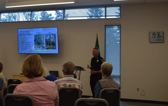 Jared Moravec, deputy fire chief, addresses a fire mitigation class on Monday. The class aims to help homeowners reduce the risk of fire on their property.