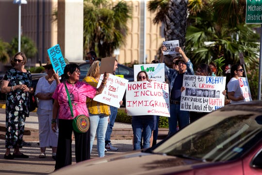 Joining with a nationwide Close the Camps protest, people protest outside Rep. Michael Cloud's office on Tuesday, July 2, 2019. Protesters were demanding the end of family separation and the current state of the immigration policy in the United States.
