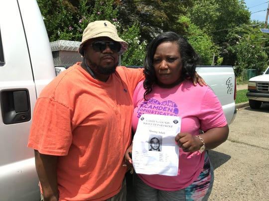 John Royal and Tawanda Jones hold a flier for Curtis Jenkins III, a 20-year-old Camden resident who was reported missing Monday.