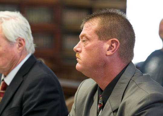 Pike County Sheriff Charles Reader listens to Judge Chris Martin during his arraignment in the Pike County Courthouse on July 2, 2019, in Waverly, Ohio. Reader plead not guilty to 16 criminal charges ranging from theft to tampering with evidence.