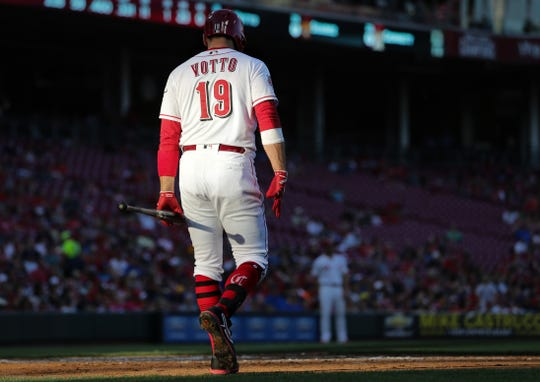 Cincinnati Reds first baseman Joey Votto (19) walks to the batter's box in the third inning of an MLB baseball game against the Milwaukee Brewers, Monday, July 1, 2019, at Great American Ball Park in Cincinnati.