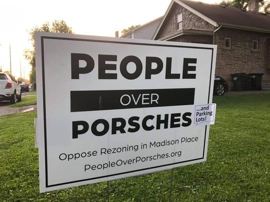 A group of residents in the Madison Place neighborhood of Columbia Township is opposing expansion plans of Porsche of the Village and other automobiles-sales businesses.