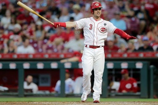 Cincinnati Reds second baseman Scooter Gennett (3) steps out of the batter's box in the sixth inning of an MLB baseball game against the Milwaukee Brewers, Monday, July 1, 2019, at Great American Ball Park in Cincinnati. The Milwaukee Brewers won 8-6.