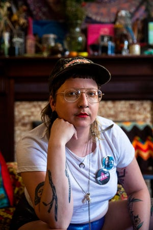 John(na) Jackson poses for a portrait in their Clifton home Monday, July 1, 2019. Jackson was denied a ride on a Cincinnati Metro bus after the Pride Festival Saturday, June 22.