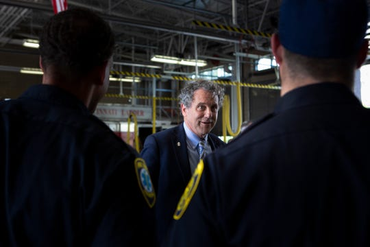 Sen. Sherrod Brown speaks to firefighters before a news conference about legislation to keep deadly synthetic opiate fentanyl out of the country and Ohio at the Cincinnati Fire Department Engine 35 on Tuesday, July 2, 2019.