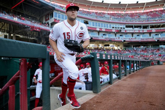 Cincinnati Reds third baseman Nick Senzel (15) takes the field before the first inning of an MLB baseball game against the Milwaukee Brewers, Monday, July 1, 2019, at Great American Ball Park in Cincinnati.