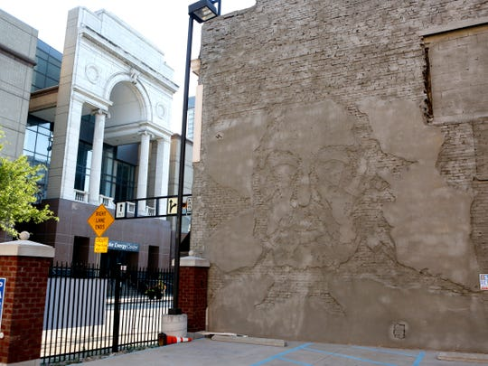 A mural created by Alexandre Farto, also known as Vhils, in 2011 in Downtown Cincinnati was covered with concrete in May.