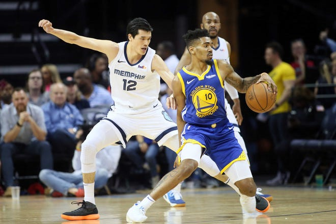 Memphis Grizzlies guard Yuta Watanabe (12) defends against Golden State Warriors guard Jacob Evans III (10) at FedExForum on April 10, 2019.