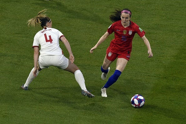 England midfielder Keira Walsh tries to stop United States midfielder Rose Lavelle during a Women's World Cup semifinal Tuesday at the Lyon Satdium in Decines-Charpieu.