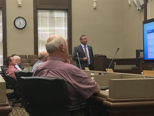 Montgomery County Mayor Jim Durrett, standing, leads a power point presentation on the proposed 2019-20 county budget this week at the courthouse.