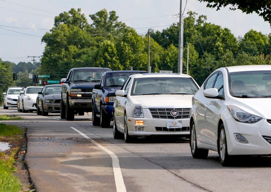 Cars line up on Whitfield Road while approaching the intersection of Whitfield and Needmore roads in Clarksville on July 1.