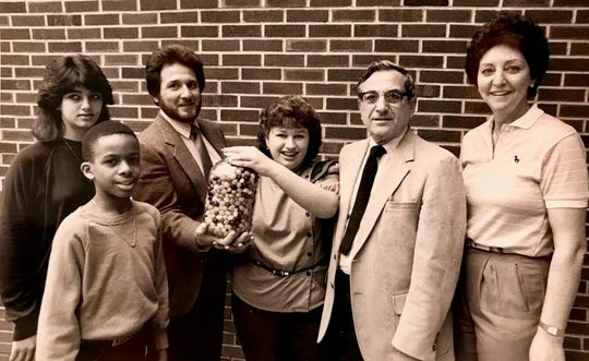 "Anthony Cataline in the days he was called ""Wolfman Jack"" by students at Soehl Junior High School in the 1980s. Also pictured are Superintendent A.R. Taranto and physical education teacher Patricia O'Halloran."