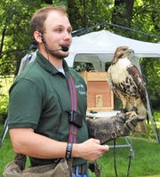 Adam McGuire of Miami Valley Falconry at a program earlier last week at Clary Gardens.