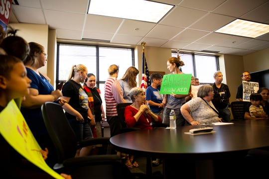 Protestors gather at Democratic Congresswoman Cindy Axne's office on Tuesday, July 2, 2019, in Des Moines to call for the closing of detention camps on the border.