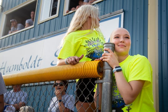 "Ashlyn Clark looks out at the softball field as the charity softball game kicks off, raising money for the Clark family on Thursday, June 27, 2019, in Humboldt. ""It's indescribable,"" Ashlyn said of the event, ""they are coming together for me."" Just days after graduating high school Ashlyn Clark wasn't feeling right and a trip to the doctor explained why. She had Hodgkin's lymphoma. The multi-sport athlete was determined to keep playing softball so between chemo treatments she still takes the field with her teammates."