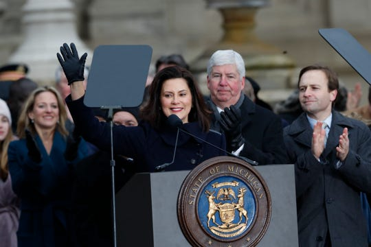 Former Gov. Rick Snyder watches incoming Gov. Gretchen Whitmer take office at the Capitol inauguration on Jan. 1, 2019.