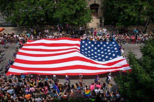 Participants take part in the 50th Chicago Pride Parade in Chicago, Sunday, June 30, 2019.