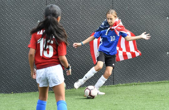 Nationals soccer team player Danielle Wisser wears an American flag during practice at Detroit Soccer District field in Detroit on July 2, 2019.