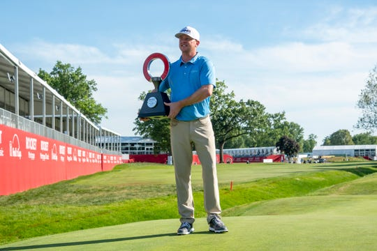 Nate Lashley holds the trophy after winning the Rocket Mortgage Classic.