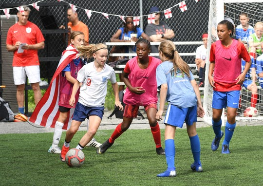 Nationals soccer team player Chole Ricketts (center) passes to fellow teammates during practice at Detroit Soccer District field in Detroit on July 2, 2019.