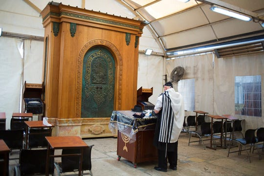 In this Wednesday, March 6, 2019 photo, a man prays in Hebron's holiest site, known to Jews as the Tomb of the Patriarchs and to Muslims as the Ibrahimi Mosque in the Israeli controlled part of the West Bank city of Hebron.
