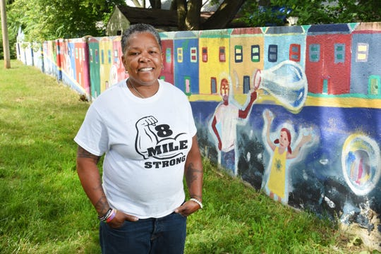 "Teresa Moon, president of the 8 Mile Community Organization,  lives across the street from the wall. Growing up, she remembers when it was a place where kids in the neighborhood would walk atop the wall as part of their coming of age. ""The teachers never told us anything about the wall,"" she said."