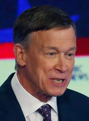 Democratic presidential candidate former Colorado Gov. John Hickenlooper speaks during the Democratic primary debate at the Adrienne Arsht Center for the Performing Arts, in Miami.