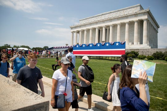 Visitors to the Lincoln Memorial are limited to a single walkway as workers set up for President Donald Trump's 'Salute to America' event honoring service branches on Independence Day, Tuesday, July 2, 2019, in Washington.