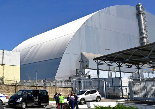 This June 1, 2019, file photo shows a view of the New Safe Confinement (NSC) movable enclosure at the nuclear power plant in Chernobyl, Ukraine. A new structure built to confine the Chernobyl nuclear reactor at the center of the world's worst nuclear disaster has been previewed for the media.