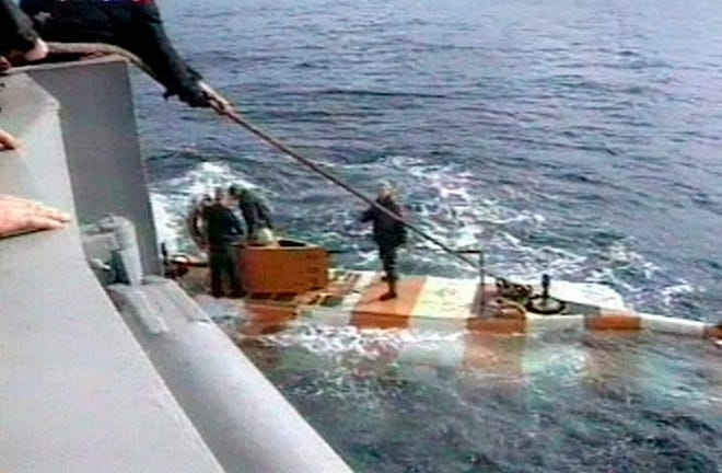 In this video grab provided by the RU-RTR Russian television via APTN , Russia rescue personnel return from a dive in a mini submarine to the Kursk on the sea bed in the Barents Sea, Russia.