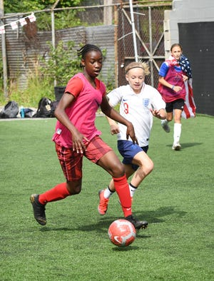 Nationals soccer team players Conamora Ndana (left) and Chole Ricketts practice at Detroit Soccer District field in Detroit on July 2, 2019.