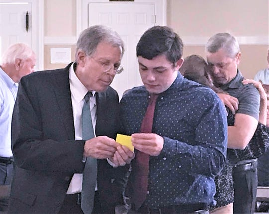 Caden Charnetski confers with his attorney, Ray Schlather, after Chemung County Judge Richard W. Rich Jr. declared him guilty of vehicular manslaughter July 2, 2019.
