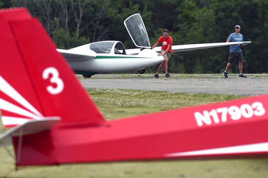 "Glider pilot Jack Vakiener, of Elmira, prepares a glider for a passenger flight June 24, 2019, at Harris Hill Soaring Corp. in Elmira. Harris Hill is known as ""The Soaring Capital of America"" and offers passenger flights, as well as soaring lessons."