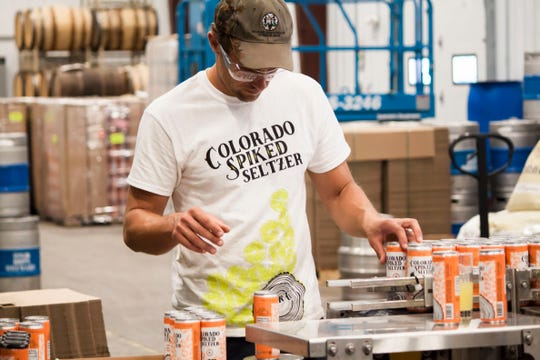 Zach Weakland, head distiller at Windsor's The Heart Distillery, works in the distillery ahead of the announcement of Colorado Spiked Seltzer.