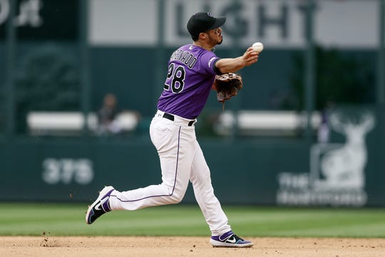Colorado Rockies third baseman Nolan Arenado, shown throwing to first base for an out in Sunday's game against the Los Angeles Dodgers, and his teammates will wrap up a two-game series against the Houston Astros with a 6:10 p.m. game Wednesday at Coors Field in Denver.