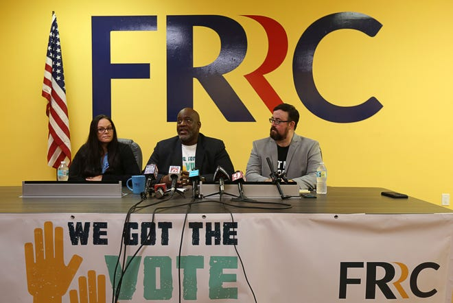 Left to Right, Jessica Younts, Florida Rights Restoration Coalition, director of operations; Desmond Meade, executive director Florida Rights Restoration Coalition; and Neil Volz, Florida Rights Restoration Coalition, political director— The Florida Rights Restoration Coalition holds a press conference to discuss a vote-registration campaign, on Tuesday, July 2, 2019. The Coalition helped lead efforts to pass a constitutional amendment aimed at restoring voting rights of felons.  (Ricardo Ramirez Buxeda/Orlando Sentinel via AP)