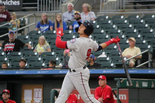 Fort Myers Miracle outfielder Trevor Larnach, who leads the FSL in batting average, staring at a ball he hit.