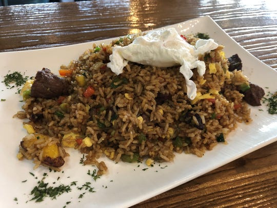 Chaufa is Peru's take on fried rice. At The Llama's House, the dish ($15.99) includes sweet plantains and steak, with a perfectly poached egg perched atop it.