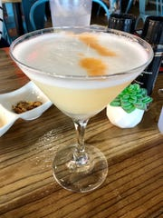 A properly foamy pisco sour from The Llama's House in Estero.