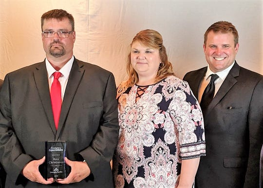 Ross Christensen of Oconto, left, was named KBX Logistics' 2018 Driver of the year. He is pictured after receiving the award with his wife Courtney and Wes Kornowske, vice president of operations for Paper Transport Inc., based in De Pere, for whom Christensen drives.