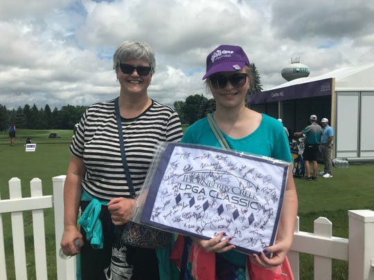 Brenda Liermann and her daughter Greta show off the many autographs from LPGA golfers Tuesday at the Thornberry Creek LPGA Classic in Hobart.